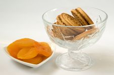 Free Dried Apricots On Plate And Cookies In A Vase Stock Images - 14287994