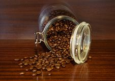 Free Coffee Beans Spilling Out Of A Cristal Jar Royalty Free Stock Photos - 14288238