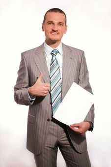 Free Businessman With A Blank Paper Royalty Free Stock Photography - 14288707