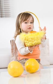 Little Girl With Fruits Stock Photos