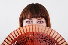 Free Young Woman Looking Through A Hand Fan. Stock Photos - 14292503