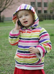 Free Little Girl Talking On The Phone Stock Images - 14293674