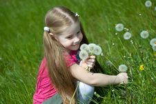 Little Girl With Dandelions Royalty Free Stock Photos