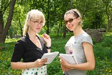 Two Young Students In The Park Stock Image
