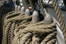 Free Row Of Ropes Tied Around Wooden Cleats Stock Photos - 1434073
