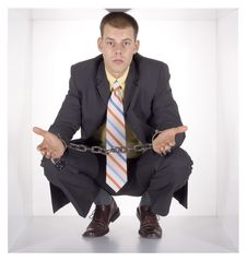 Free Chained Businessman In The Cube Royalty Free Stock Image - 1434876