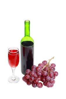 A Bottle Of Wine, A Glass And A Bunch Of Grapes. Stock Image