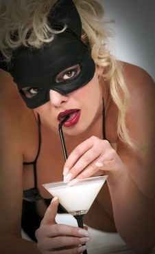 Free Blond Model Wearing Black Cat, Drinking Milk Stock Image - 14302711
