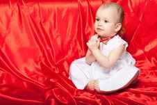 Free Cute Baby On The Red Silk Cloth Royalty Free Stock Photography - 14304687