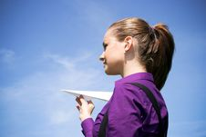 Young Businesswoman With Paper Plane In The Hand Royalty Free Stock Photos