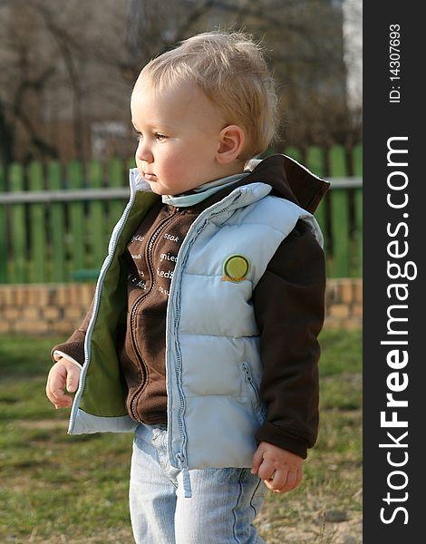 Baby boy in jerkin at playground