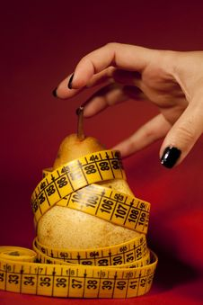 Free Pear With Measuring Tape Stock Photos - 14311133