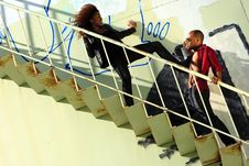 Free African-American Male & Female Fighting On Stair Royalty Free Stock Images - 14312559