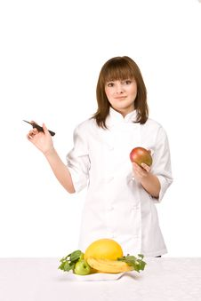 Free Cook Girl Holding A Knife And A Mango Royalty Free Stock Photos - 14312958
