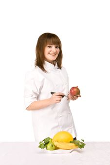 Free Cook Girl Holding A Knife And A Mango Stock Photo - 14312960