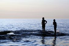 Free Boy S Silhouettes In Refreshing Water Stock Photo - 14313760