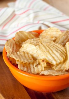Potato Chips In Orange Bowl Stock Image