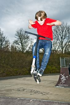 Free Boy Going Airborne With A Scooter Stock Photography - 14314872