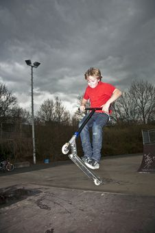 Free Boy Going Airborne With A Scooter Royalty Free Stock Photos - 14314898