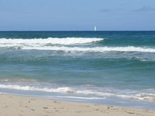 Beach And Sailing Boat Stock Images