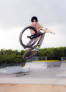 Free Young Boy Going Airborne With Bike Royalty Free Stock Photo - 14315535