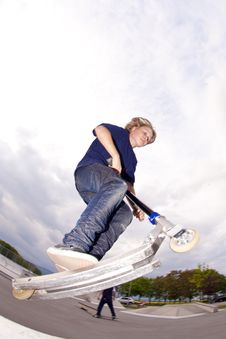 Free Young Boy Going Airborne With Scooter Royalty Free Stock Photos - 14315548