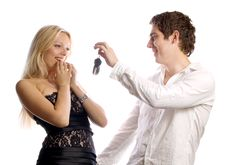 Free Man Is Presenting Car Keys For His Girl Royalty Free Stock Photos - 14316138