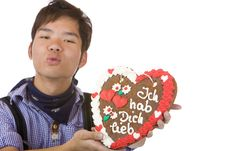 Free Chinese Holds Oktoberfest Gingerbread Heart Royalty Free Stock Photos - 14319158
