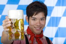 Free Happy Asian Man Holds Oktoberfest Beer Stein Stock Images - 14319174
