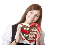 Free Bavarian Woman In Love Holds Oktoberfest Heart. Royalty Free Stock Photos - 14319178