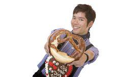 Free Asian Man In Lederhose Holds Oktoberfest Pretzel Stock Images - 14319184
