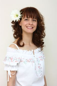 A Smiling Woman With A Flower In Her Hair Stock Photos