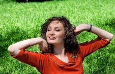 Free Young Woman Stretches In  Grass Royalty Free Stock Images - 14320469