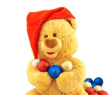 Toy Bear In A Christmas Cap Royalty Free Stock Photography