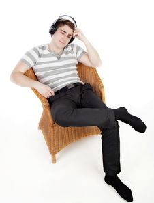 Free Young Man Is Relaxing On Armchair Stock Image - 14323731