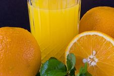 Oranges With Juice Royalty Free Stock Photography