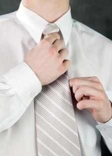Free Businessman Is Adjusting His Tie Stock Images - 14324124