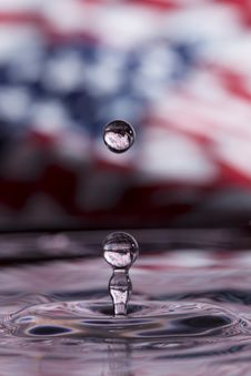 Water Drop In Front On US Flag Stock Images