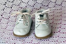 White Leather Baby Shoes Royalty Free Stock Images