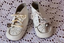 Soft White Leather Baby Shoes Royalty Free Stock Images