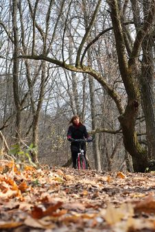 Free Young Female Bicycle Rider In Autumn Park Stock Photo - 14330980
