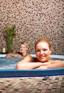 Two Young Women In Hot Tub Royalty Free Stock Photography