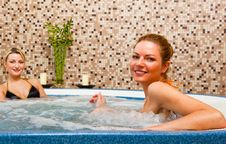 Two Young Women In Hot Tub Stock Photo