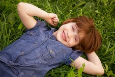 Free Little Girl Lying On Grass Stock Photography - 14332332