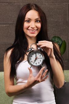 Free Beautiful Woman Holding Vintage Clock Stock Photography - 14334812