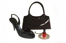 Black Shoe, Handbag And Silver Necklace Royalty Free Stock Images