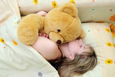 Free The Girl Sleeps With A Toy Bear Royalty Free Stock Images - 14335849
