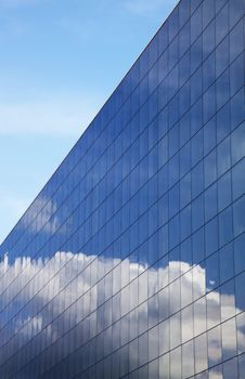 Modern Office Building And Blue Sky Reflection Royalty Free Stock Photos