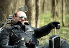 Biker Sitting On His Motorcycle Stock Photography