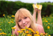 Young Woman Laying Down In Meadow Stock Photos